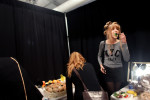 A model has a bite to eat before a fashion show, September 12, 2012, at Mercedes-Benz Fashion Week in New York, NY. (For The New York Times)