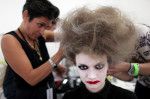 A model gets her hair and make-up done before the Thom Browne show at Mercedes-Benz Fashion Week in Manhattan, New York, on September 09, 2013. (For The New York Times)
