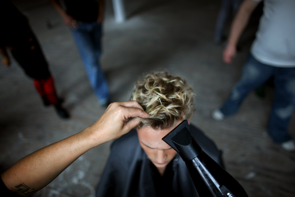 Hair prep backstage, September 11, 2009, at Mercedes-Benz Fashion Week in New York, NY. (For The New York Times)