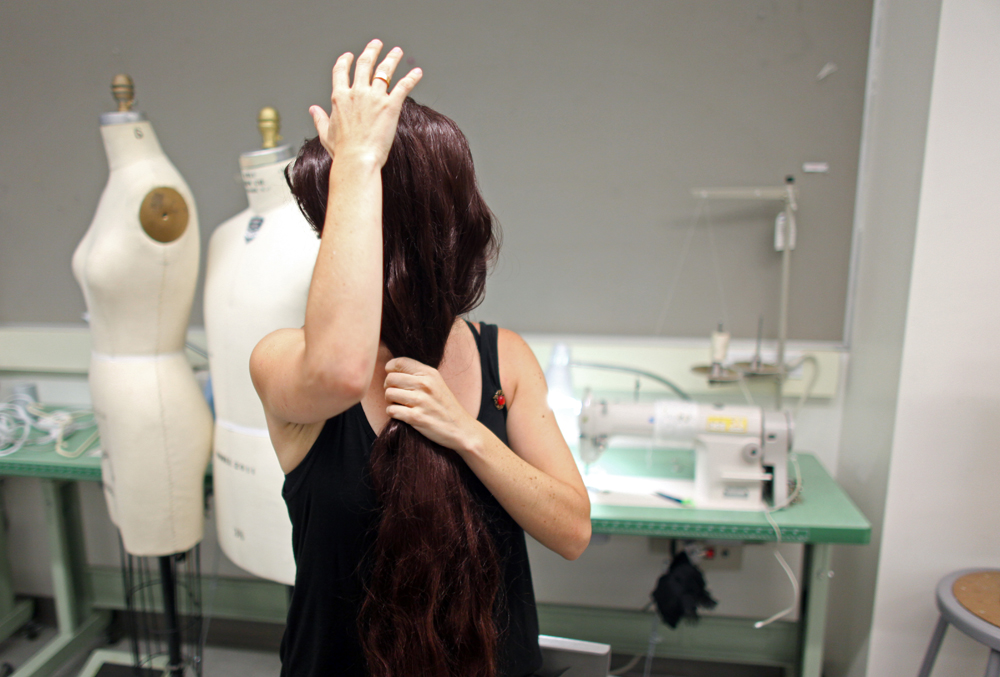 Lucia Cuba shows a front wig from her accessory collection at Parsons The New School for Design in Manhattan, New York on Monday, July 23, 2012. (For The New York Times)