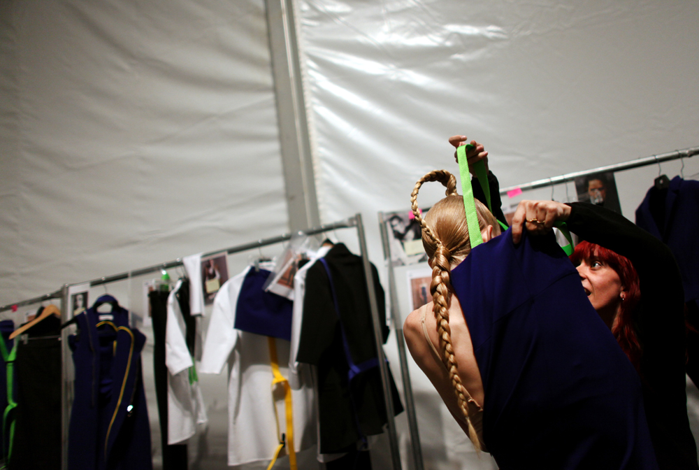 A model gets dressed before the Davidelfin show during the last day of the Mercedes-Benz Spring 2011 Fashion Week at the Lincoln Center on Thursday, September 16, 2010. (For The New York Times)(For The New York Times)