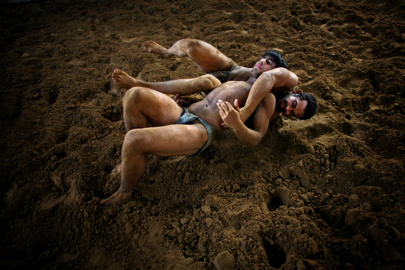 Indian men practice traditional Kushti wrestling on Monday, June 01, 2009 in New Delhi, India.