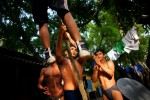 Indian men who practice traditional Kushti wrestling climb rope on Monday, June 01, 2009 in New Delhi, India.