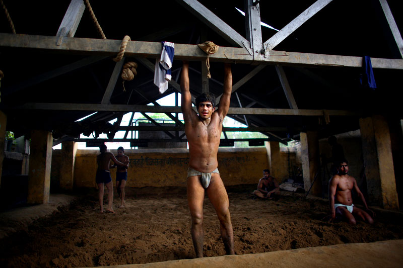 Indian men who practice traditional Kushti wrestling take a break on Monday, June 01, 2009 in New Delhi, India.