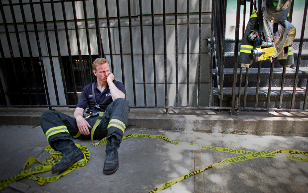 New York City Fire Department firefighter Terence O'Donnell rests after working on the scene of a crane collapse on Manhattan's Upper East Side at 91st Street and 1st Avenue on May 30, 2008 in Manhattan, New York. The crane collapsed on top of an apartment building crashing into a penthouse apartment and falling to the ground. (For Getty Images)