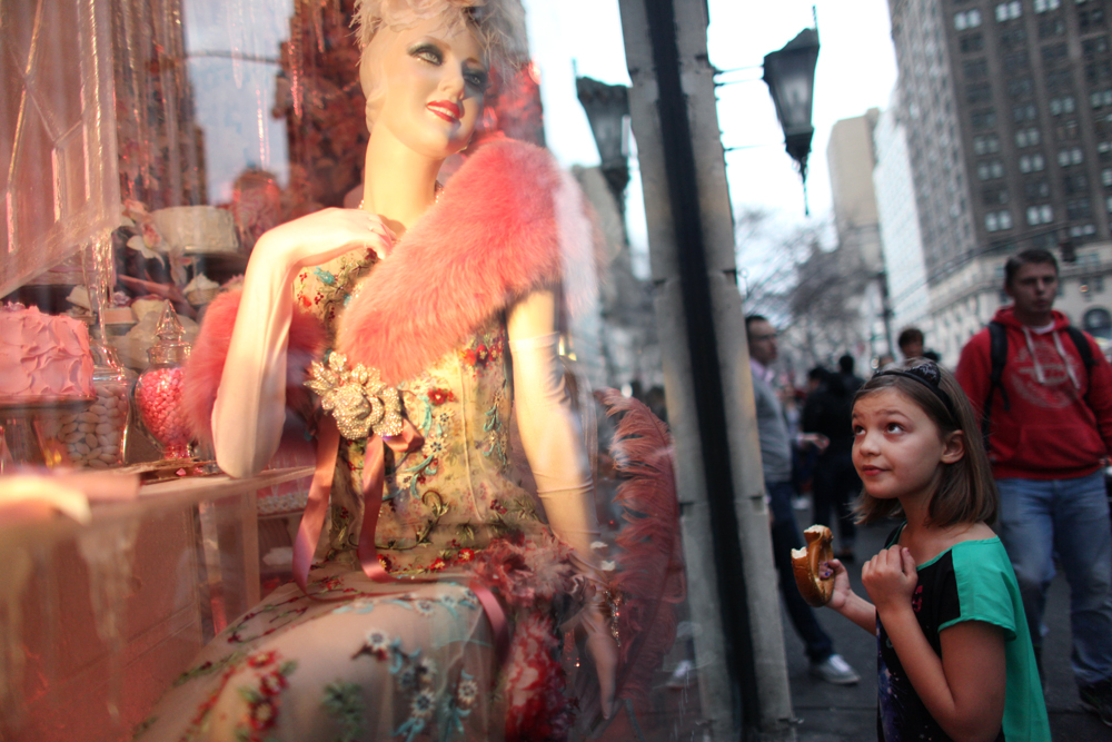 Eight-year-old Lauren Mulligan, dressed for the warm weather, checks out the holiday storefronts of Bergdorf Goodman in Manhattan, NY on December 22, 2013. The temperatures of the day were projected to reach an uncharacteristic for December high of 70 degrees Fahrenheit.