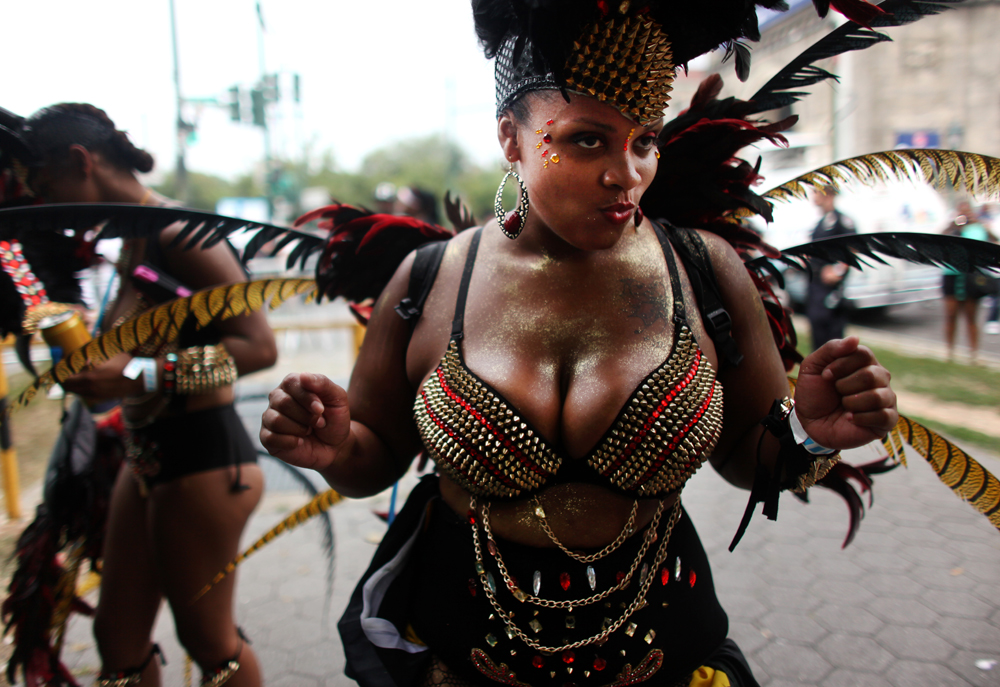 A costumed dancer prepares to participate in the 46th annual West Indian parade on Labor Day on Monday, September 02, 2013, in Brooklyn, New York. (For New York magazine)