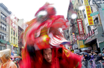 A participant in the Chinatown Lunar New Year Parade fiddles with his mask in Manhattan, NY on February 25, 2018.