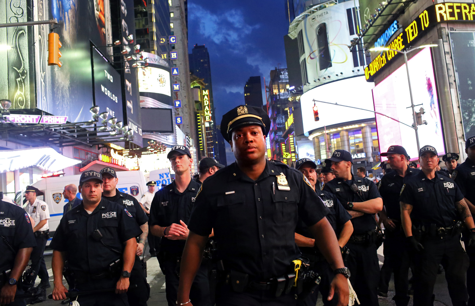 Police watch activists protest in Times Square in response to the recent fatal shootings of two black men by police, July 7, 2016 in New York, NY. Protests and public outcry have grown in the days following the deaths of Alton Sterling on July 5, 2016 in Baton Rouge, Louisiana and Philando Castile on July 6, 2016, in Falcon Heights, Minnesota. (For Getty Images)