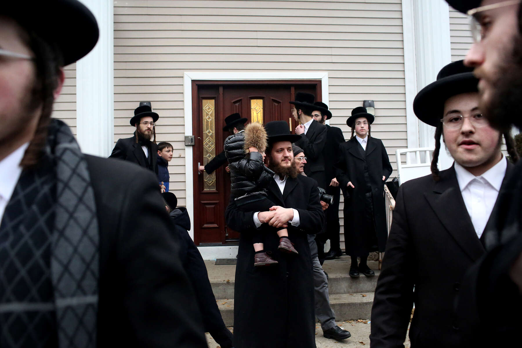 A crowd gathers for Hachnosas Sefer Torah in front of 47 Forshay Road in Monsey, NY, on December 29, 2019, where suspect Grafton Thomas, 38, stabbed 5 people at a Hanukkah gathering the previous evening. Anti-Semitic attacks are on the rise around the country — and in New York City, anti-Semitic crimes have risen by 21 percent in the past year, according to the Anti-Defamation League. (For The New York Times)