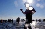 Swimmers run into the ocean during Coney Island Polar Bear Club's New Year's Day Plunge in Brooklyn, NY on January 01, 2017. (For Getty Images)