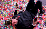 A man rolls around in confetti on New Year's eve in Times Square in New York, NY just after midnight on January 01, 2017.(For Getty Images)