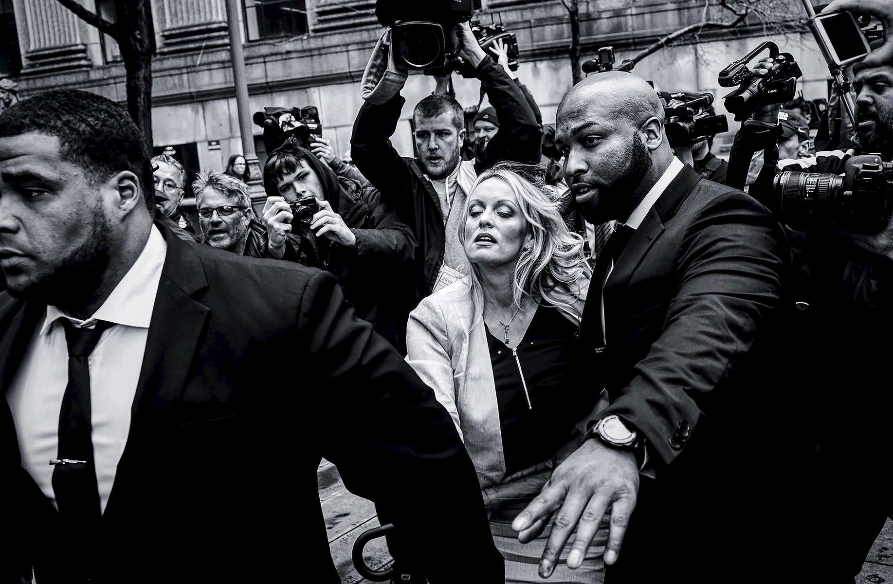 Adult film actress Stormy Daniels (Stephanie Clifford) arrives to Federal Court with her lawyer Michael Avenatti (not seen) at the United States District Court Southern District of New York after a hearing related to Michael Cohen, President Trump's longtime personal attorney and confidante, April 16, 2018 in New York City. Cohen and lawyers representing President Trump are asking the court to block Justice Department officials from reading documents and materials related to his Cohen's relationship with President Trump that they believe should be protected by attorney-client privilege. Officials with the FBI, armed with a search warrant, raided Cohen's office and two private residences last week.Photo by Yana Paskova/Getty Images