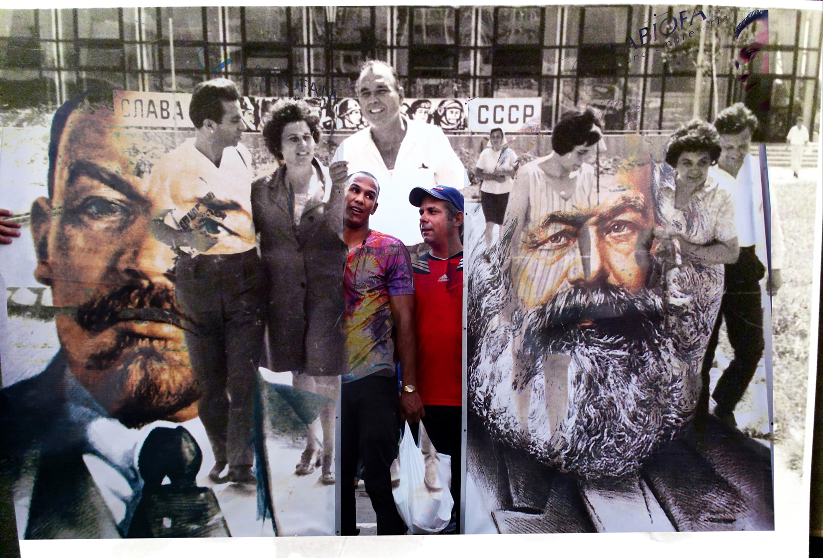 My grandfather (center,) seen walking with Romanian and Bulgarian colleagues in Bulgaria in the 1970s. The banner in the background reads {quote}Glory to the USSR.{quote} And in Cuba, participants in the First of May Labor Day parade hold posters of Russian Communist leader Vladimir Lenin and German Communist revolutionary Karl Marx. This day, known as Día del Trabajo, is a call for people of all nations to show support to socialism and the Cuban Revolution. While attendance is not mandatory, absences from these marches are usually noted and discouraged.