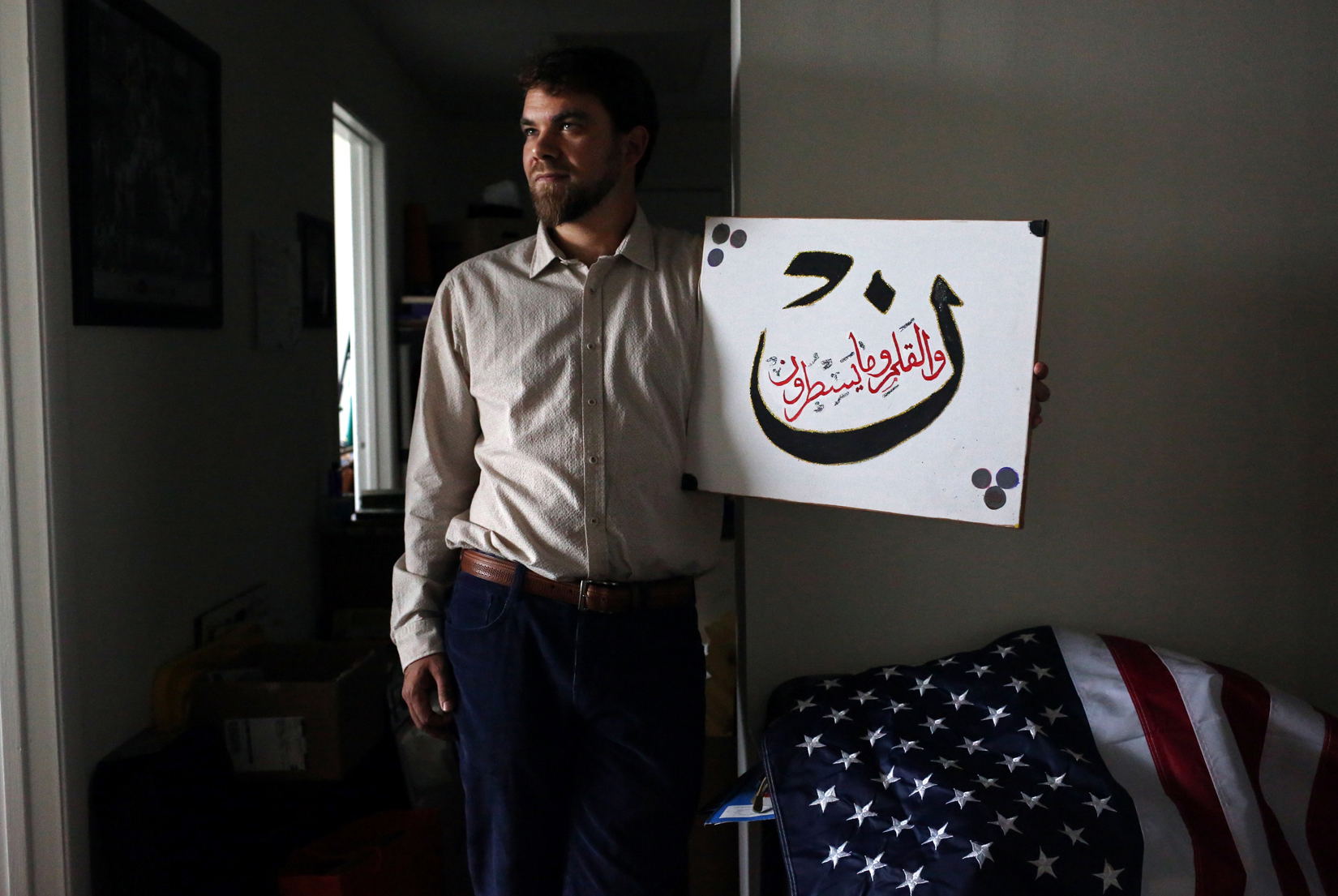 "A small and fascinating subset of Muslim Americans express an interest in voting for U.S. presidential candidate Donald Trump. In Florida, a particularly large proportion of Muslim Republicans (approx. 2 out of every 3, according to CAIR,) have such leanings - Trump's business background and apparent ability to self-finance eclipsing his anti-immigrant, Islamophobic rhetoric as priorities. Adam Warshauer, 37, seen here posing for a portrait with a passage from the Surat Al-Qalam in the Koran in Delray Beach, has a Jewish father and Christian mother, and became a Sufi Muslim at 22. Warshauer says he plans to support Trump, especially if he becomes the Republican nominee for president, and that he does not believe he wants to ban Muslims' entry to the country because of a dislike for them. ""Most are outraged at Trump saying he wants to ban Muslims from entering America, but I support that as a Muslim person, because we have to stop what is happening and work with other Muslim countries to stop terrorism. An example of Trump being a problem solver is his proposal for building the wall along the Mexico border - that's a solution to illegal immigration. But I am worried about his approach to foreign policy, since he is a bit aggressive. Then again, Putin respects him and that's good; we want Putin to respect our country."" Warshauer adds that {quote}Trump says a lot of dumb things, and I'd like to help him. I'm not necessarily a 'Trump Trump Trump!' first pumper, but I am being a realist, and if he is going to win, I want to support him to make the best decisions for our country.{quote}(For TIME magazine)"