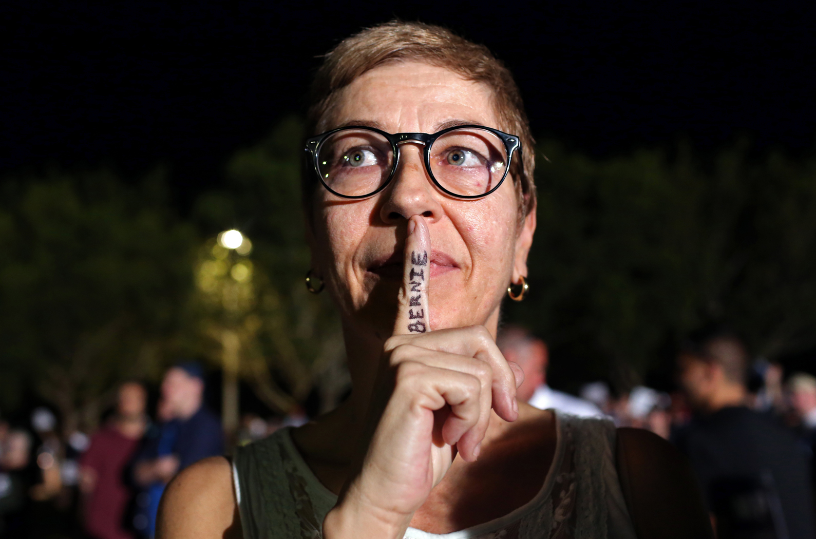 Pam Becker, 51, poses for a portrait with the name of U.S. Presidential candidate Bernie Sanders (I-VT) written on her finger at a rally for candidate Donald Trump (R-NY) at Sunset Cove Amphitheater in Boca Raton, FL, on March 13, 2016. Becker, a Democrat, says of her attendance to a Trump rally: {quote}It's hard to argue against someone if I don't have the knowledge. Simply calling people names is not an argument.{quote} Photo by: Yana Paskova
