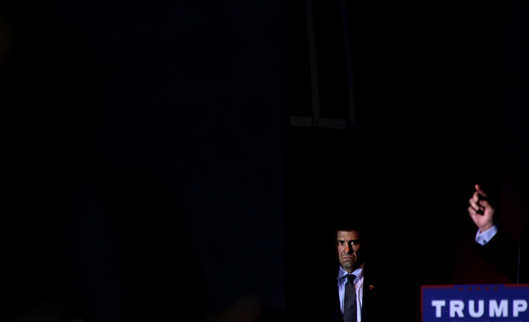 (L-R) A Secret Service agent surveys the crowd as U.S. Presidential candidate Donald Trump (R-NY) speaks at a rally at Sunset Cove Amphitheater in Boca Raton, FL, on March 13, 2016.(For TIME magazine)