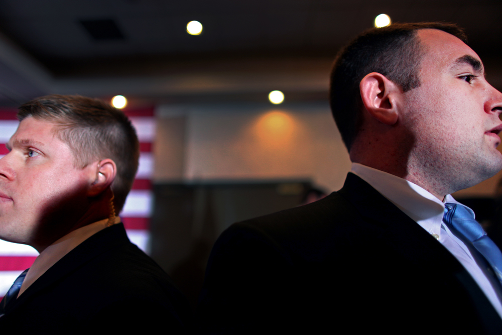 Secret Service agents watch Republican Presidential candidate Mitt Romney (R-MA) greet the crowd after speaking at Bakers of Milford in Milford, Michigan on Thursday, February 23, 2012. (For The New York Times)