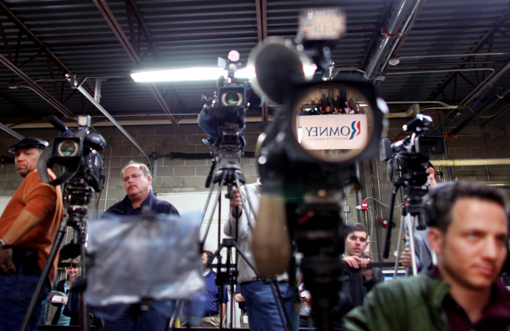 A sign is reflected in a video camera as the media wait for Republican Presidential candidate Mitt Romney (R-MA) to speak at Meridian Bioscience in Cincinnati, Ohio on Monday, February 20, 2012.