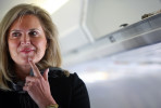 Ann Romney, wife of Republican Presidential candidate Mitt Romney (R-MA), listens to him speak with reporters on their plane before it takes off from Columbus International Airport in Columbus, Ohio on Tuesday, March 06, 2012. (For The New York Times)