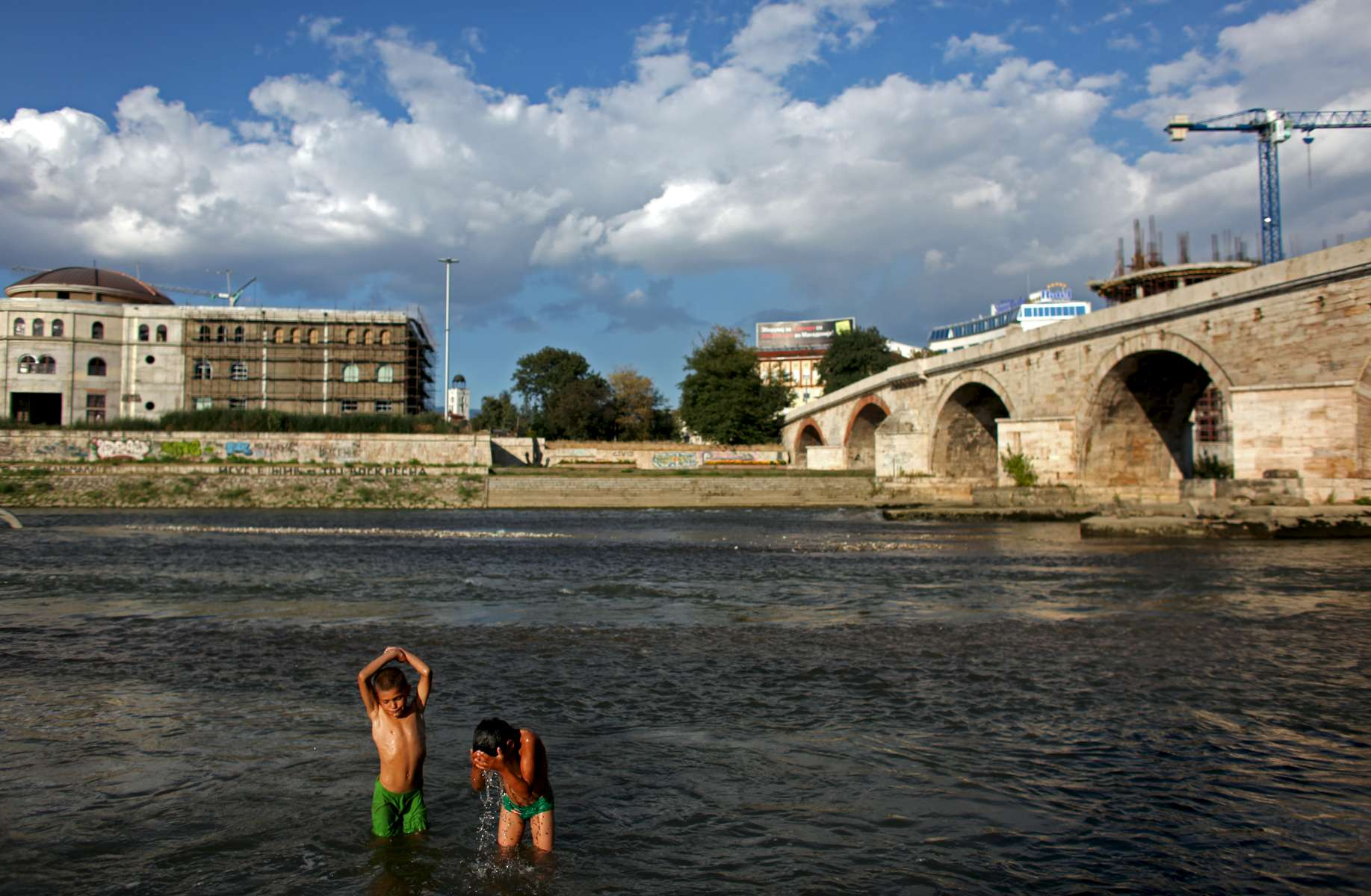 (L-R) Two Macedonian gypsy boys, Elis and Martin, swim in the river Vardar near the Stone Bridge in Skopje, Macedonia on Sunday, September 05, 2010.  (For The New York Times)(For The New York Times)(For The New York Times)