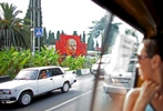 Investors have flooded the Russian beach town of Sochi since its award as the 2014 Winter Olympics location in an effort to create a Mediterranean-style resort. Here, a bus rider glances at a mural of the Russian communist politician Vladimir Lenin on Tuesday, August 12, 2008. As the mountainous Black Sea resort Sochi, Russia, prepares for the Winter Olympic games scheduled there for 2014, it emerges as a place replete with contradictions -- glitzy clubs and impoverished street vendors, progress and repression, Westernization and former Eastern bloc ideologies.(For The New York Times)