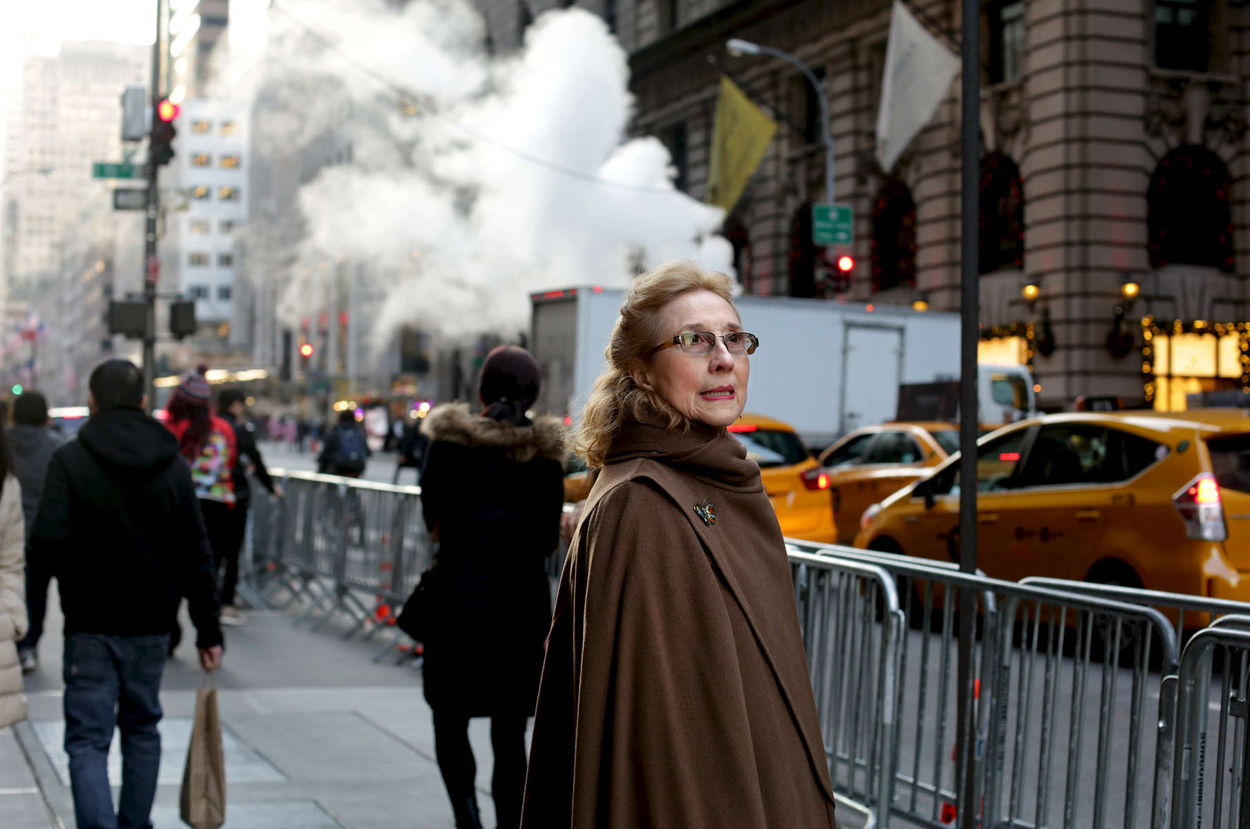 "A passerby gazes at Trump Tower, the current residence of Republican President elect Donald Trump, in Manhattan, NY on November 28, 2016.-""Trump Gawkers{quote} is a visceral look at what draws people to Trump Tower, the current residence of U.S. President elect Donald Trump. Hoards of people undertake the trek, bearing security and weather roadblocks, to stare, gawk, absorb, record. The magnetism to the tower (and by extension, to the man inside it,) manifests in the sheer numbers of daily visitors, as well as in the fascination etched across their faces. Upon first look, the time so many spend there seems like sport and amusement, but underneath upturned eyes and selfie smiles prevails an undercurrent of anxiety - and not just for those who didn't want Trump in the Oval Office. Some of the electorate that voted against Hillary is now unsure for which version of Trump they voted. People's upward gazes, no matter their political views, seek answers: How could this happen? Or now that it has, what will it mean?"