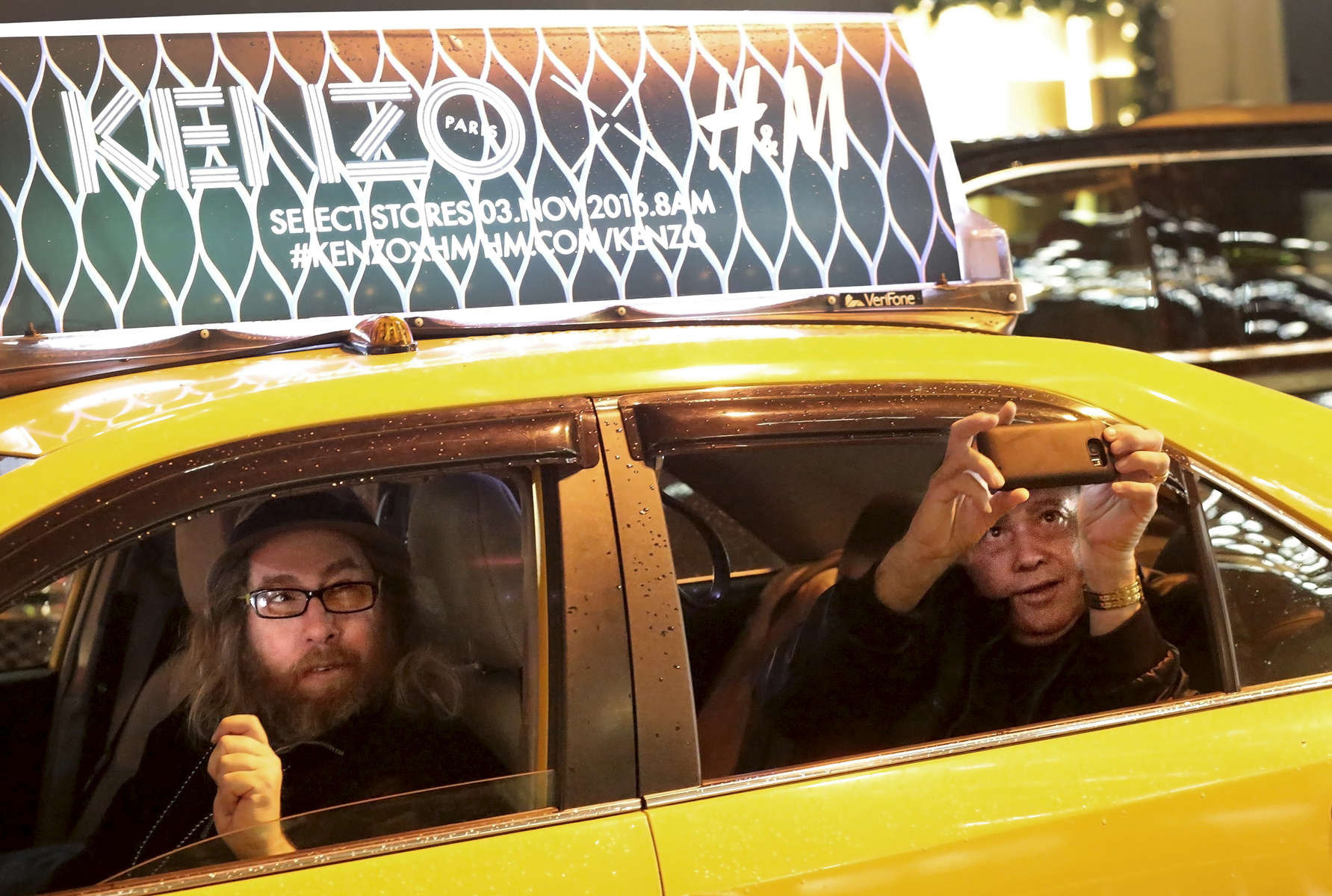 A passerby photographs Trump Tower, the current residence of Republican President elect Donald Trump, from a cab in New York, NY on November 25, 2016.-{quote}Trump Gawkers{quote} is a visceral look at what draws people to Trump Tower, through in-depth interviews and still photos - a project I started the day after the election. At first, I simply followed where my assignments sent me, but then found myself returning to the place on my own, unable to look away - and I wasn't alone. Hoards of people undertake the trek, bearing security and weather roadblocks, to stare, gawk, absorb, record. The magnetism to Trump Tower (and by extension, to the man in the tower,) manifests in the sheer numbers of daily visitors, as well as in the fascination etched across their faces. Upon first look, the time so many spend there seems like sport and amusement, but underneath upturned eyes and selfie smiles prevails an undercurrent of anxiety - and not just for those who didn't want Trump in the Oval Office. Some of the electorate that voted against Hillary is now unsure for which version of Trump they voted. People's upward gazes, no matter their political views, seek answers: How could this happen? Or now that it has, what will it mean?