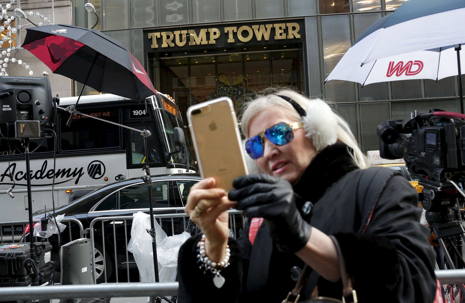 Debra Tomarin takes selfie in front of Trump Tower, the current residence of Republican President elect Donald Trump, in New York, NY on December 08, 2016. Tomarin is a real estate agent and retired psychotherapist - and lives in Palm Beach, FL, down the street from Trump's Florida residence, Mar-a-Lago. On people protesting Trump's nomination of Oklahoma Attorney General Scott Pruitt as the head of the Environmental Protection Agency - a man who has sued the EPA more than a dozen times to block air, water and climate protections - outside of Trump Tower, she said: {quote}Protesting is irrelevant and wrong, and won't make a difference. He won't even see it, and people don't stop to pay attention. We have to move on. It's too late to sell anti-Donald Trump buttons. They should be asked to leave. Sure, they have a right to be out here, but what about his right to live in a home without someone standing in front of it with a sign?{quote}On climate change, she said, {quote}I believe climate change is real. I am not concerned about this because of his choices of cabinet people and because his children understand climate change is real. But maybe he hasn't been paying attention so far, being so busy with his business, and now he has to.{quote}On Pruitt as the choice to lead the EPA, she said: {quote}Pruitt as the head of the EPA is an interesting appointee. I think that's making a statement that he'll turn this guy around. This guy, Pruitt, is aware of climate change despite being against it. Trump did this because he's gotta please the people. Trump has a strategy - he takes the underdog and turns him around because he likes a challenge. Sometimes people do the opposite of what they want to do, because they like a challenge. There's a method to his madness. You don't want a guy you can just push over, and he wants a challenge in this guy. This is his strategy - who's going to pay attention to a guy who is simply for battling climate change as opposed to a guy who's against it, yet actually ends up battling it? Now that's a wake-up call.{quote}-{quote}Trump Gawkers{quote} is a visceral look at what draws people to Trump Tower, through in-depth interviews and still photos - a project I started the day after the election. At first, I simply followed where my assignments sent me, but then found myself returning to the place on my own, unable to look away - and I wasn't alone. Hoards of people undertake the trek, bearing security and weather roadblocks, to stare, gawk, absorb, record. The magnetism to Trump Tower (and by extension, to the man in the tower,) manifests in the sheer numbers of daily visitors, as well as in the fascination etched across their faces. Upon first look, the time so many spend there seems like sport and amusement, but underneath upturned eyes and selfie smiles prevails an undercurrent of anxiety - and not just for those who didn't want Trump in the Oval Office. Some of the electorate that voted against Hillary is now unsure for which version of Trump they voted. People's upward gazes, no matter their political views, seek answers: How could this happen? Or now that it has, what will it mean?