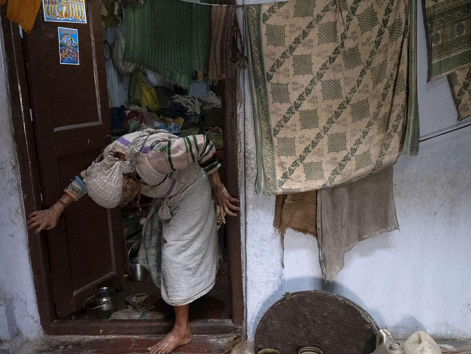 A widow exits her room at Pashupatinath Ashram in Varanasi, India on January 06, 2019.