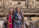 (L-R) Widows Shakuntala Devi, who estimates she is 70 years old, and Durga Devi, who estimates she is 60 years old, pose for a portrait at Birla ashram in Varanasi, India on January 05, 2019. Durga, originally from Rajasthan, is a god-sister and cousin with Shakuntala. Durga says of her friendship with Shakuntala: {quote}On one side is the river Ganga, and on the other, Baba Vishwanath (Lord Shiva.) We are right in between - there isn't a better place.{quote}Durga says she did not want to live with her son following her husband's death, as she wanted to be closer to the holy river Ganges and Lord Shiva. She often visits her son, who insists that she stay at home and looks after her well. But she says she prefers the ashram.