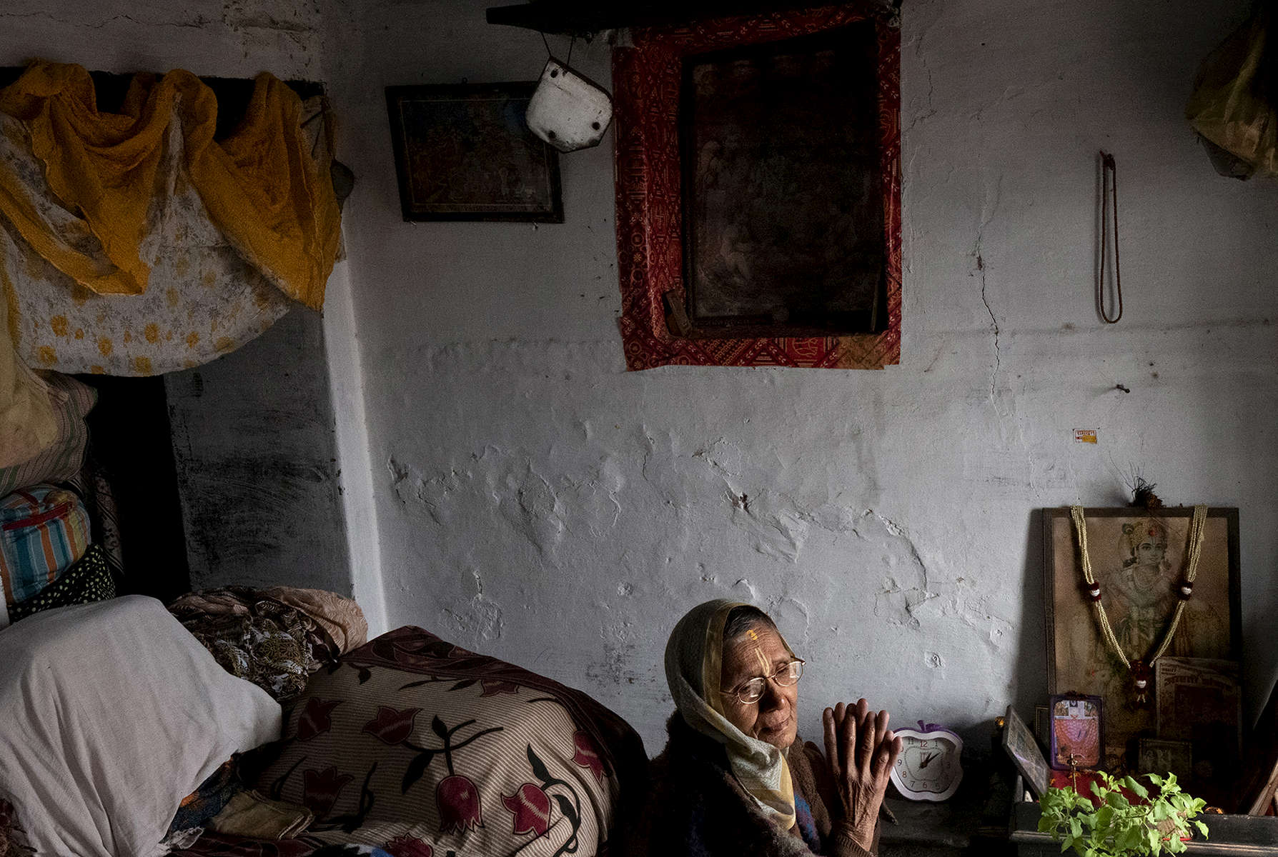 Meena Devi, 78, a widow, begins to pray at Rak Kuti ashram in Varanasi, India on January 07, 2019. Meena is originally from Nepal, and has lived in the ashram for the past 25 years. Before that, she lived in the same building as Sita Devi, 52, and her mother-in-law, Goma Devi, 96, who now also occupy this ashram. Meena is a child widow. {quote}Maybe I was cursed and I would have been forbidden to attend any functions because my husband died at a young age,{quote} she says. So with the help of relatives she moved here to live among other widows. She didn't want to marry again after her husband's death.