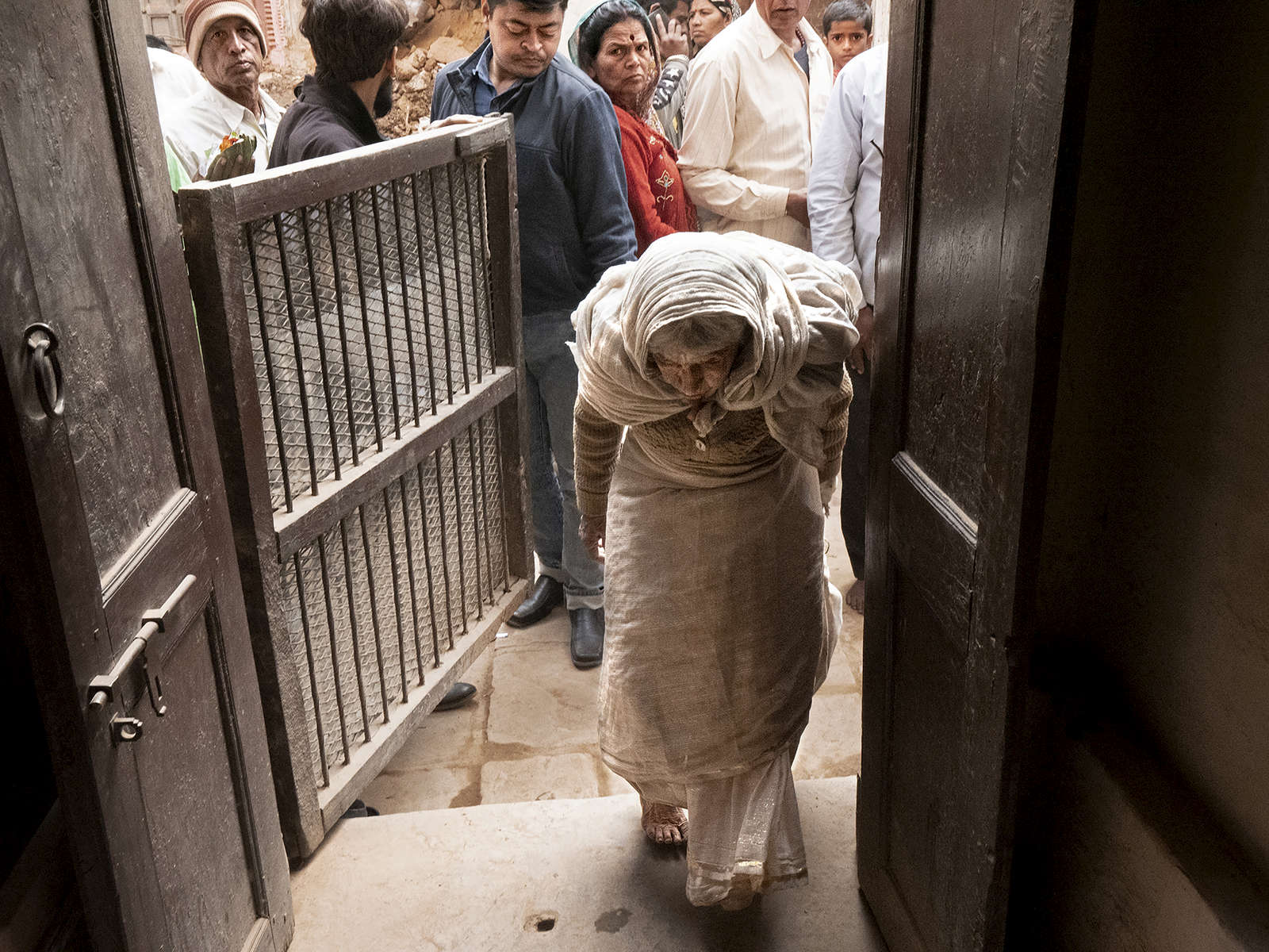 Ratan Devi Mata, 82 years old, enters Birla ashram in Varanasi, India on January 05, 2019. Ratan is originally from Nepal. After her husband left her for another woman a day following their wedding, she tried to live with her in-laws, but daily fighting motivated her to join the ashram instead. Ratan believes she will attain Moksha (release from the cycle of rebirth) if she dies here. She receives a monthly pension of 2,000 rupees from Sulabh International.