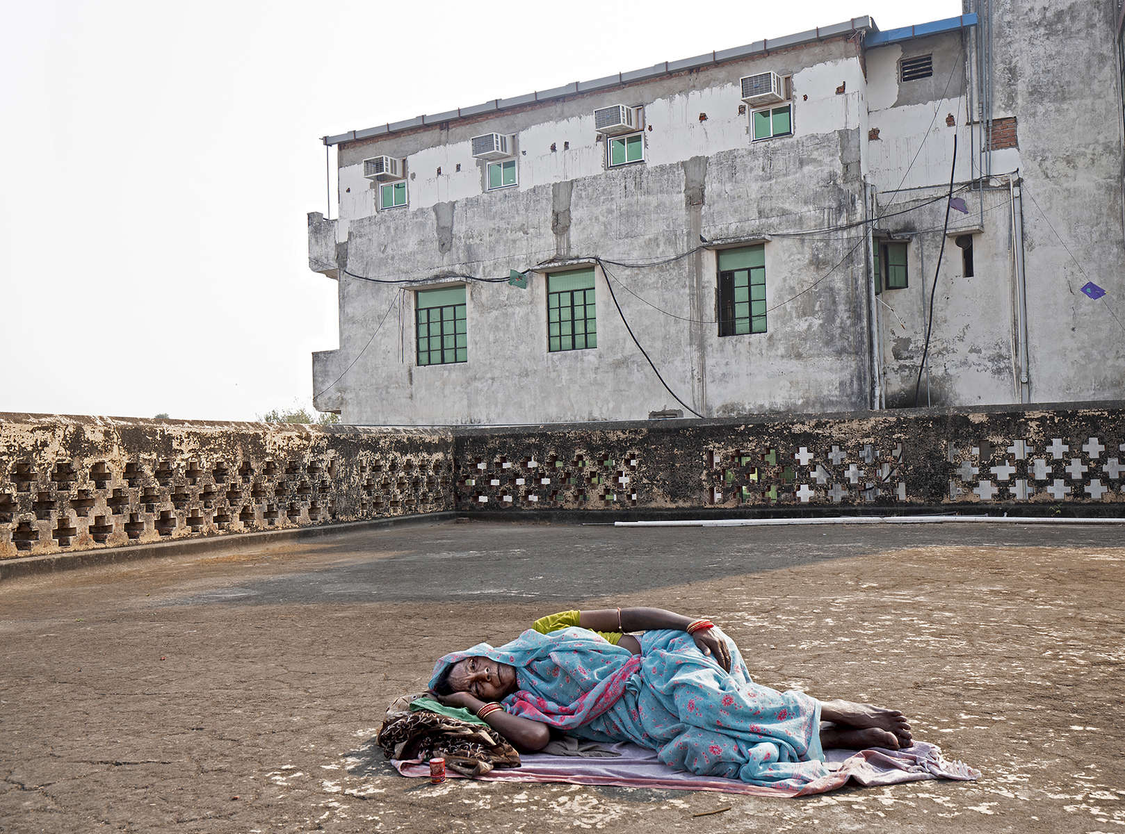 Sonakshi Devi, a widow, lies on the roof of the Durga Kund Help Line ashram in Varanasi, India on January 08, 2019.