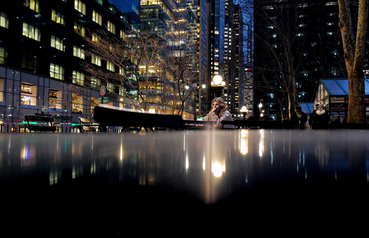 A woman rests at Bryant Park table in Manhattan, New York on January 07, 2020.