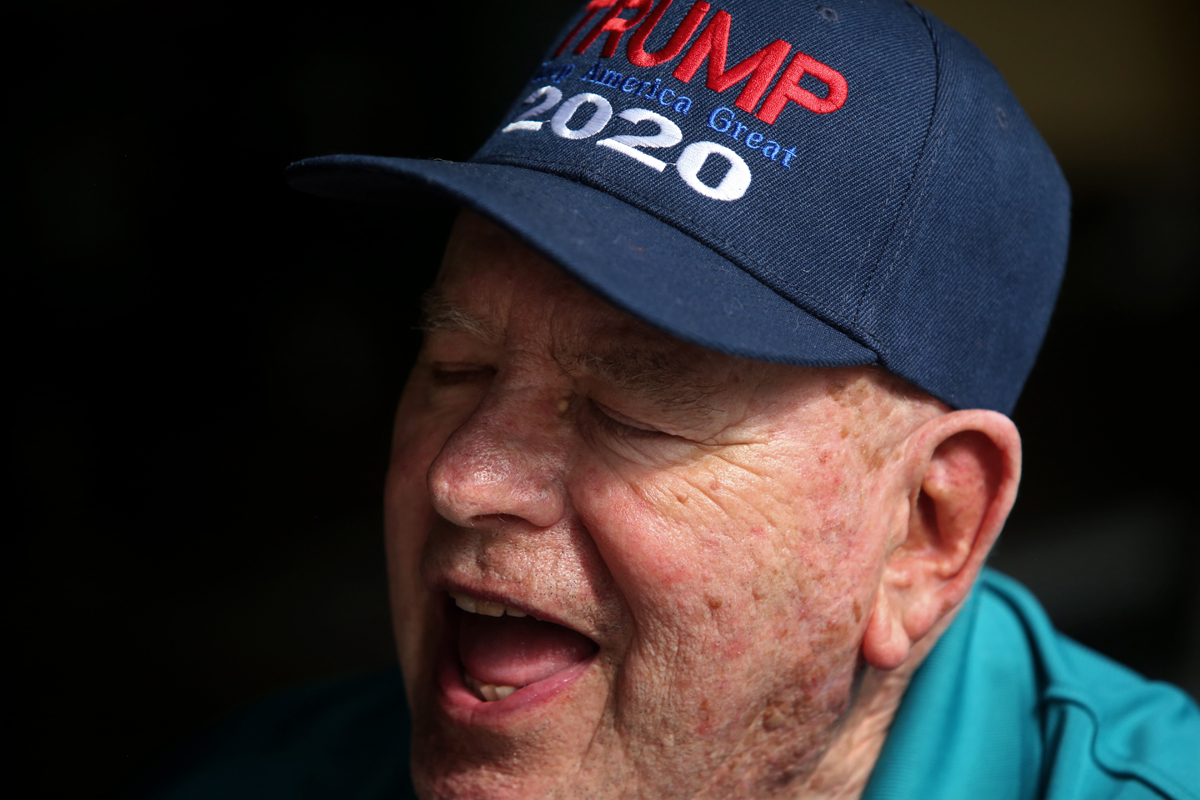 Bear Brace, 78, dines with friends at Amerikano's Grille at Spanish Springs Town Square amid coronavirus (COVID-19) cases in The Villages, Florida, U.S. March 16, 2020. Brace says that while he believes he is being careful, as he has suffered from diabetes and cancer, that he would still like to go out with his friends. REUTERS/Yana Paskova