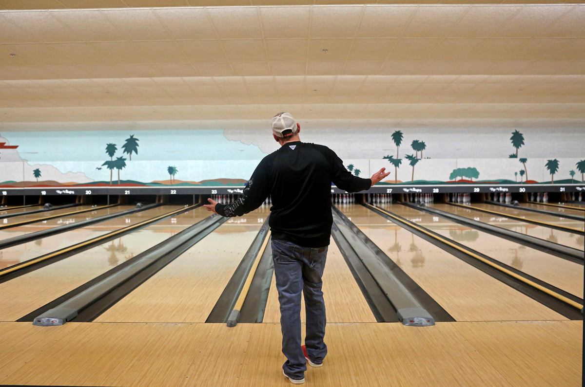 A man bowls in a nearly empty bowling alley inside McCall's Tavern at Spanish Springs Town Square amid coronavirus (COVID-19) cases in The Villages, Florida, U.S. March 16, 2020.  REUTERS/Yana Paskova