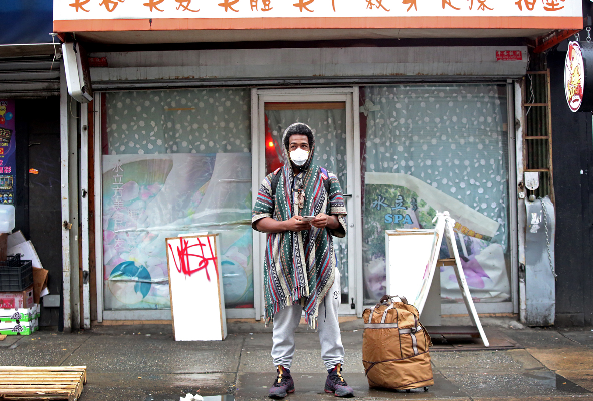 A man wears a mask in Chinatown in New York, U.S., February 13, 2020, at the start of the novel coronavirus outbreak. Chinese American denizens have reported an uptick in hate speech and crimes ever since U.S. president Donald Trump's racist characterizations on the pandemic's initial spread from Wuhan, China. REUTERS/Yana Paskova