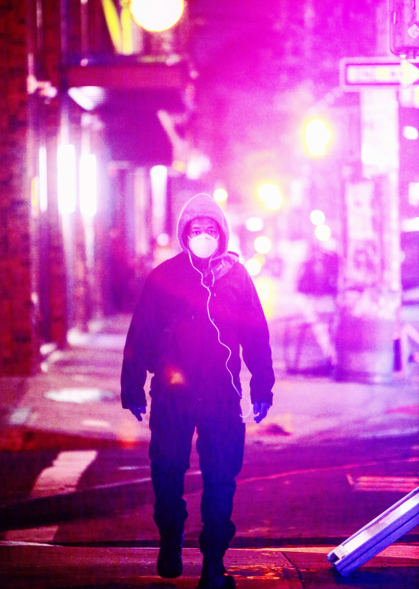 A masked man walks through an empty Williamsburg at night as the coronavirus rages inside its North American epicenter, New York, on April 05, 2020. (Yana Paskova/Getty Images)
