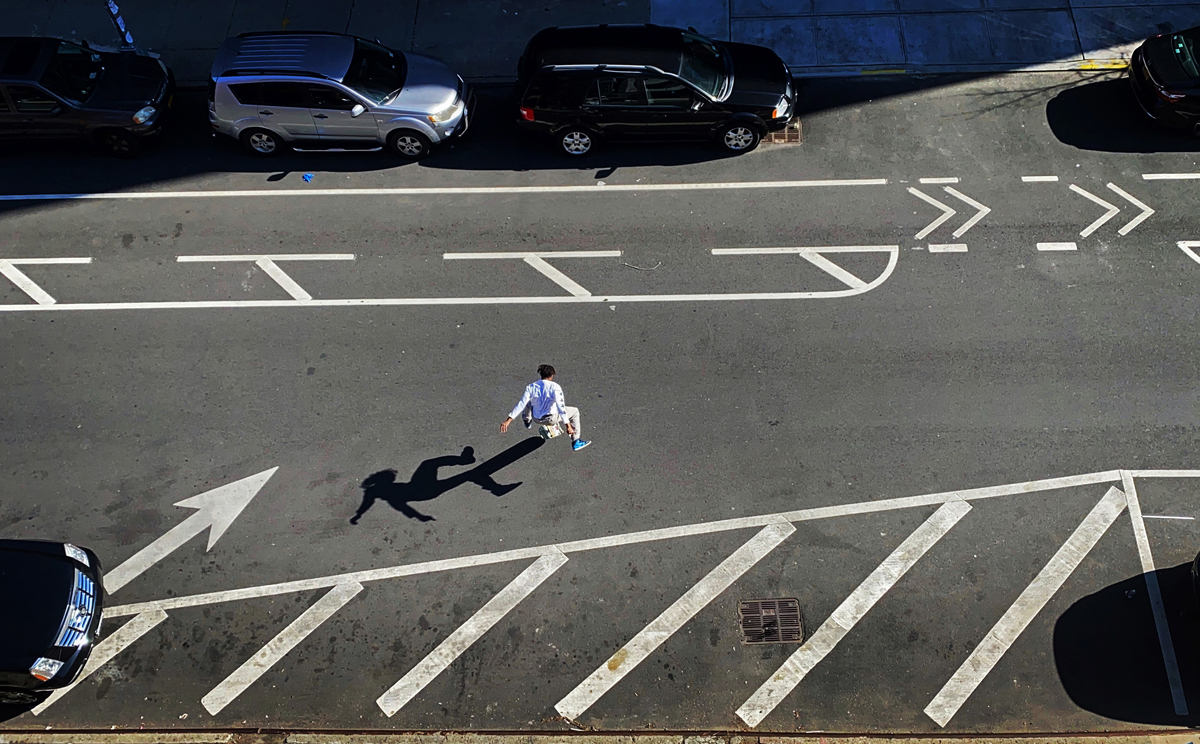In a world that has paused its humans, humans reclaim the asphalt; a skateboarder soars above an emptied avenue in Brooklyn, NY on April 06, 2020.