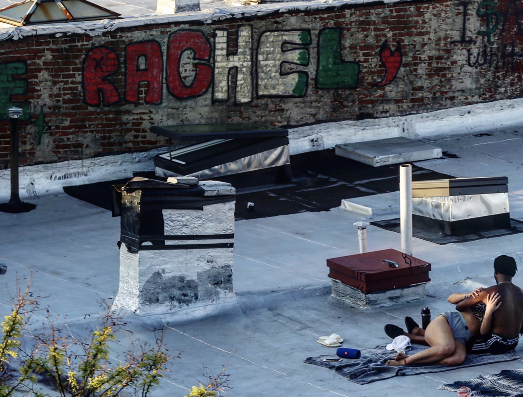 A couple sunbathes on a Bedstuy roof, in Brooklyn, NY on May 03, 2020.