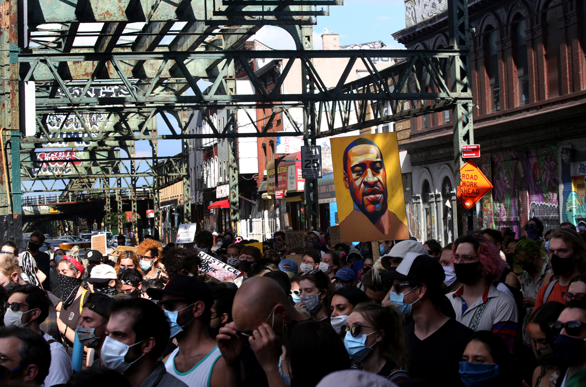 A Black Lives Matter protest goes underway beneath the Broadway MTA tracks in Brooklyn, NY on June 12, 2020.