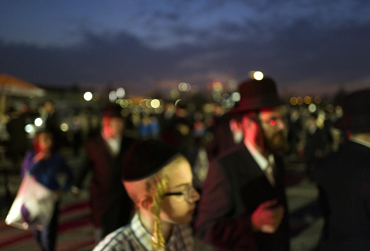 Orthodox Jewish men gather for Sukkoth prayer on August 24, 2020.