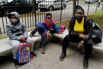 (R-L) Suly Bernardez, 31, and her children, Dixon Ordonez-Bernardez, 6, and Kimany Green-Bernardez, 8, wait to figure out a problem with their digital learning system outside of the East New York Elementary School of Excellence in Brooklyn, NY, which is taking social distancing measures to halt the spread of coronavirus at the start of the school year on September 29, 2020. (Photo by Yana Paskova/For The Washington Post)