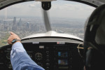 Jack McGrath of Hortman Aviation points out the Philadelphia skyline as his student pilot gets some hands-on experience in the cockpit of a small plane.