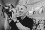 NFL Films President Steve Sabol handles the 1941 Bell and Howell movie camera his father used to film Steve's football games at Haverford School starting in 1951.