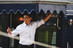 US Democratic presidential candidate Senator Barack Obama waves to supporters at the Wynnewood Station near Philadelphia, PA.