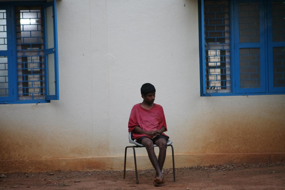 Martin, who is intellectually disabled, sits alone while the other children finish their snacks. He was found physically abused and living on the streets after both of his parents died and was eventually brought to Morning Star.