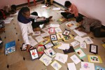 John Kennedy Samson lays out the children's drawings that he tries to sell as a way to raise money for the orphanage since it lacks any government sponsorship. {quote}Paying for the education is the toughest. I am disappointed in life sometimes when I give everything and still it is not enough.{quote}
