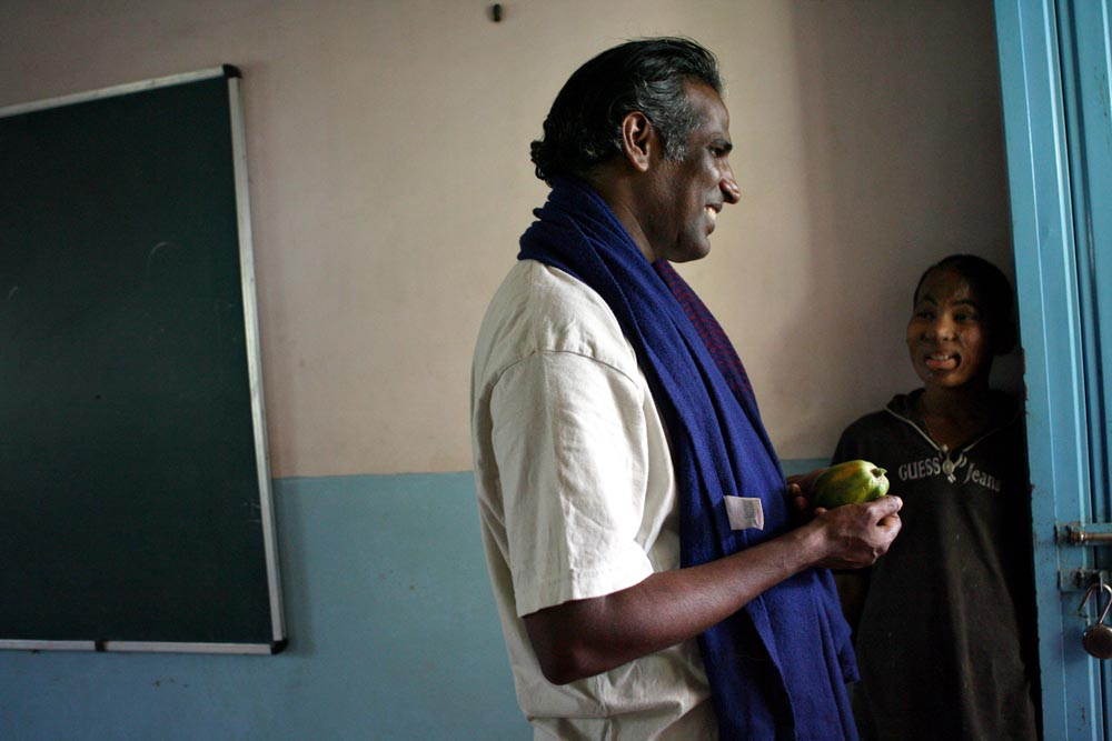 John Kennedy Samson, director of Morning Star, stops to talk with Babu in the school room. {quote}When children smile it gives me a lot of encouragement. When they hug me, love makes everything different for me. I become very full,{quote} Samson said.